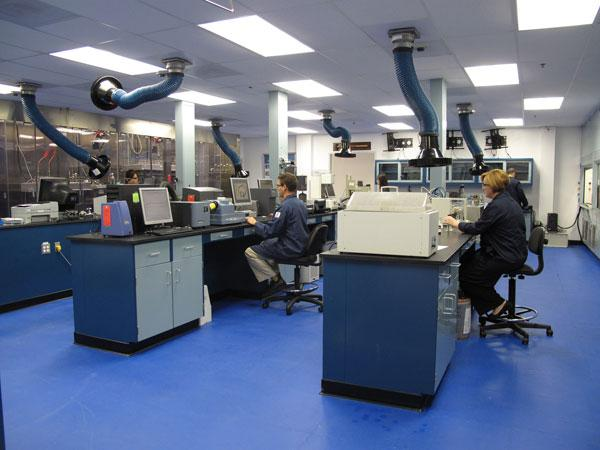 Inside Nalco Co.'s energy service division in Sugar Land, research scientists work on new energy chemical technologies. Now that Nalco's energy services division has merged with Champion Technologies, the scientists will have new projects to work on.