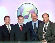 From left, F1's Louis Gilbert, partner; Dion Podgurny, president; Art Huffman, principal; and Mike Oller, principal.