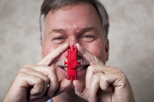Mark Franklin, president of IPT Global, holding a model version of a blow-out preventer.