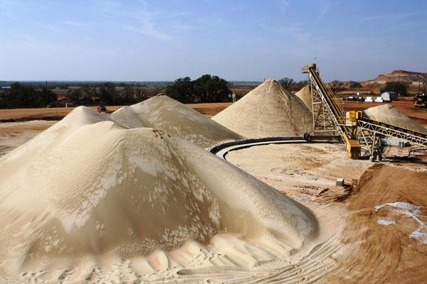 Hi-Crush Partners LP, a Houston-based frac sand company, saw units tumble 30 percent Tuesday after announcing the end of a key contract with Baker Hughes Inc.