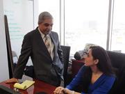 Charania talks with his daughter, Sehr Charania, who is senior manager for external affairs.