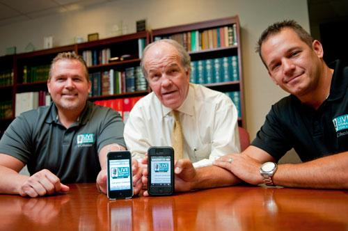Rob Johnson, center, an investor in the company, with John Carlew, left, and Lee Nicholas, two of three founders of Live Feedback Now, showing off the smartphone software, which is designed to help restaurants offer better service.