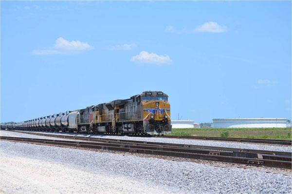 A Union Pacific unit train transporting crude oil. The company has created 785 jobs in Texas in response to the boom in oil and gas drilling activity.