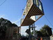 This installation shot shows the module being placed around the staircase.