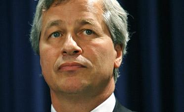 JPMorgan Chase CEO Jamie Dimon saw his pay slashed in half for his responsibility in a big trading loss last year.