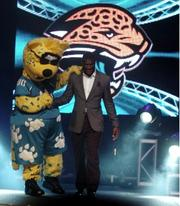 Rookie wide receiver Justin Blackmon with mascot Jackson DeVille.