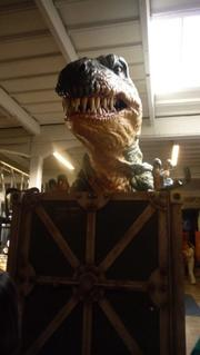 The animatronic Tyrannosaurus Rex greeted visitors as they arrived at the epoch project news conference.