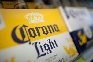 The Justice Department is blocking Anheuser-Busch's move to buy Grupo Modelo, the producer of Corona.