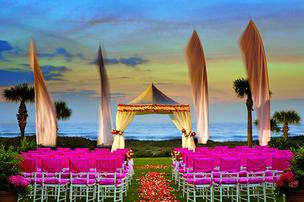 A fuschia-infused oceanview wedding setup at the Ritz-Carlton, Amelia Island. Amanda Lavin, catering sales manager at the resort, said the average wedding sees about 120 guests.      Click through the slideshow to see more.