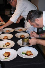 Chef Brian Siebenschuh of restaurant Orsay putting the finishing touches on his beef Wellington, the fourth course.