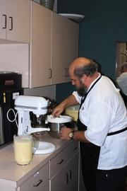 Chef Scott Schwartz preparing eggnog for the dessert.Dessert was served in the mezzanine with holiday cookies and wine.