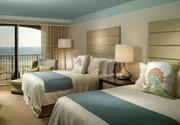 The model rooms, show here with two queen beds, are completed and showcase the beach decor and furnishings of the new resort rooms.