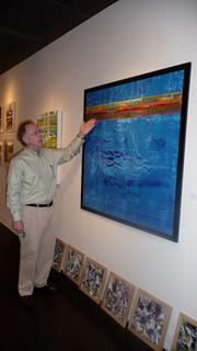 """Jack Allen discusses the colors and techniques he used in a painting in his """"Belt"""" series at the Southlight Gallery, 6 E. Bay St., Downtown Jacksonville."""