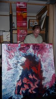 Developer Jack Allen discusses two of his abstract paintings that will be hung in the Southlight Gallery at 6 E. Bay St. in Downtown Jacksonville.