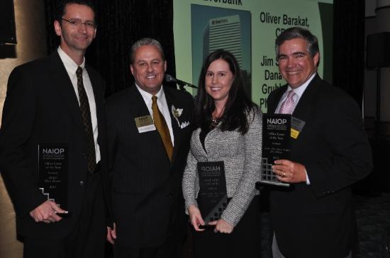 Gordy Steadman, NAIOP president, (second from left), congratulates, from left to right, Oliver Barakat, senior vice president with CBRE Group Inc. in Jacksonville, Dana Canto, an office specialist with Grubb & Ellis/Phoenix Realty Inc. and Jim Sebesta, principal of Phoenix, for the office lease of the year, EverBank Financial Corp.'s 270,000 square foot lease in the AT&T Tower in Downtown Jacksonville.