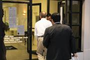 FDIC employees enter the bank.