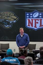 NFL Commissioner shares a laugh at the Fan Forum Thursday.