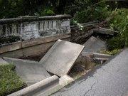 The bridge and sidewalk collapsed at the bridge near Boone Park.