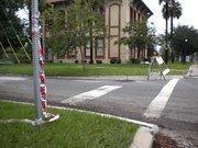 Police tape on a stop sign at Hendricks Avenue. Flood waters made Hendricks Avenue impassable last year.