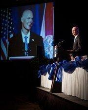 Florida Governor Rick Scott addresses the Cornerstone Regional Development Partnership in March 2011. The Organization is now called JAXUSA Partnership.