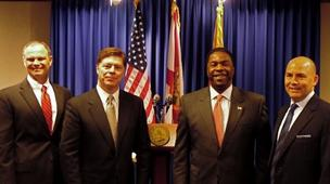 Mayor Alvin Brown with (from left) National Healing Corporation's CFO Bill WIlliams, COO Greg Martin and CEO Jeff Nelson (far right).