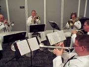 Five members of the Navy Band, Southeast, played military marches and patriotic songs at the ceremony.