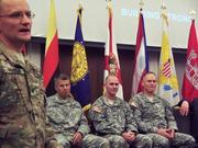 Outgoing Commander Col. Alfred A. Pantano Jr. speaks during the change of command ceremony. In the background, from left to right, are Major Gen. Todd T. Semonite, USACE deputy chief of engineers/deputy commanding general; incoming Commander Col. Alan M. Dodd and Col. Eric R. P. Conrad.