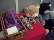 On a table in the Jacksonville Main Library sat the flowers, dolls and stuffed bears presented to the Pantano family.