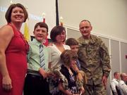 The Pantano family poses for photos on stage at the change of command ceremony.
