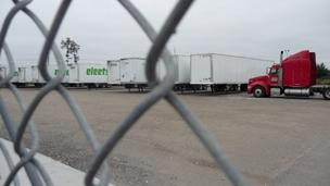 Rows upon rows of trucks bearing the Eleets logo remain behind chain link fences.  A sign posted on the company's from door says they have gone out of business.