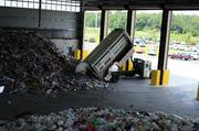 As many as 50 trucks will unload recyclables each day at the facility.