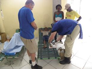 Dr. Richard Picerno II cares for a little boy's wounds after the 7.0-magnitude earthquake in Haiti.