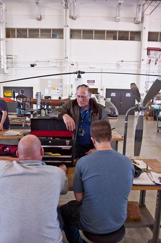 Aviation instructor James G. Naylor speaks to some students during an aviation maintenance lab at Florida State College at Jacksonville's Aviation Center of Excellence at Cecil Field.