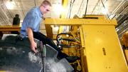 A shop technician works on a piece of Caterpillar equipment at Ring Power Corp. Ring Power has nine apprentices in its trade program and hopes to have up to 15 by the end of this summer.