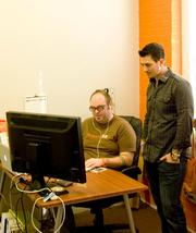 Feature [23] Designer Dan Malarkey, left, and Chief Strategist Jeremy Vaughan discuss a project at the company's St. Augustine office.