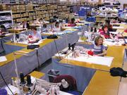 Safariland employees sew vests that will house the ballistic material in the company's bullet resistant body armor.