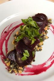 Black Hog Farm beets on red, black and green lentils in truffle vinaigrette with torn herb salad.