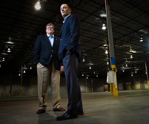 Jeff Graham of King Industrial Real Estate, left, and Aaron Zarle of Grubb & Ellis/Phoenix Realty Group in the 86,000-square-foot warehouse they recently leased out.