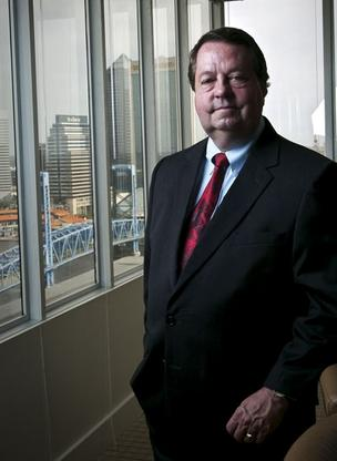 Rogers Towers attorney Bill Brinton has championed the city of Jacksonville's billboard ordinance since 1987. Now he's suing the city for not enforcing it.