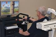 Brooks Rehabilitation Center patient Jack Giese uses the Armeo to practice arm movements.