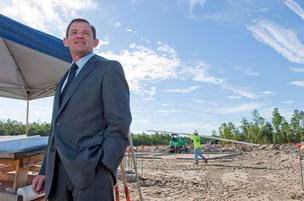 Brooks Rehabilitation Chief Operating Officer Michael Spigel stands in front of the construction site of the hospital's new Bartram campus, which will include skilled nursing, assisted living and memory care facilities.