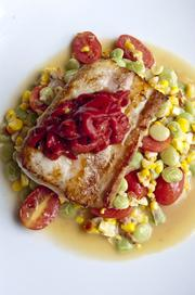 Catch of the day on lima bean succotash with applewood bacon.