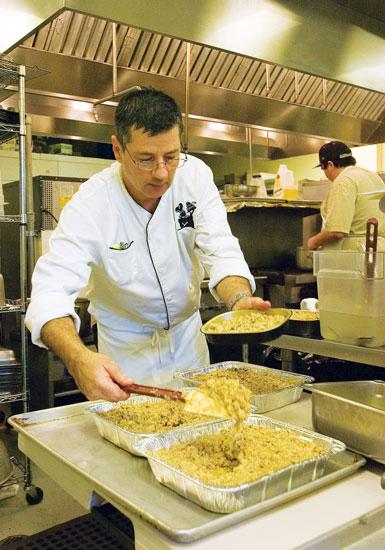 Catering by Liz Chef Fernando Silveira prepares food for the Thanksgiving holiday.