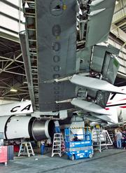 Flightstar Aircraft Services workers perform basic maintenance on, retrofit and paint aircraft at Cecil Airport. The Jacksonville Aviation Authority plans to commission a study on establishing an air cargo facility there.
