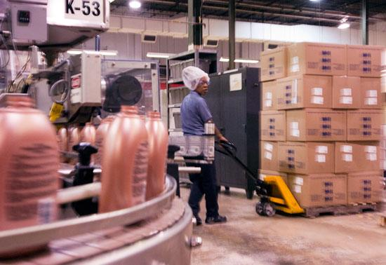 An employee moves stock at the Colomer production facility on the Westside. Colomer not only produces personal care products, but the some of the packaging as well.
