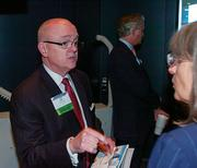 Panelist Don Shea speaks with a member of the audience after a panel discussion about the health of Downtown Jacksonville hosted by the Business Journal at EverBank Tower Dec. 4