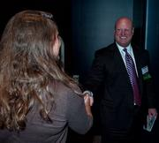 Panelist Mike Balanky speaks with a member of the audience after a panel discussion about the health of Downtown Jacksonville hosted by the Business Journal at EverBank Tower Dec. 4