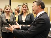 New Jacksonville University President Tim Cost chats with JU employees Jessica Swick, left, and Kaiti Chambers at a Feb. 5 welcome reception for Cost and his wife, Stephanie, at JU's Davis College of Business.