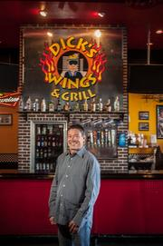Rick Akam, chief operating officer of Dick's Wings and Grill, said the restaurant's parent company is poised to buy and grow similar small chain restaurants.