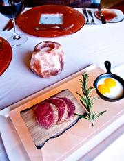 """Steak & Eggs"" served on a 250 million-year-old Himalayan salt block."